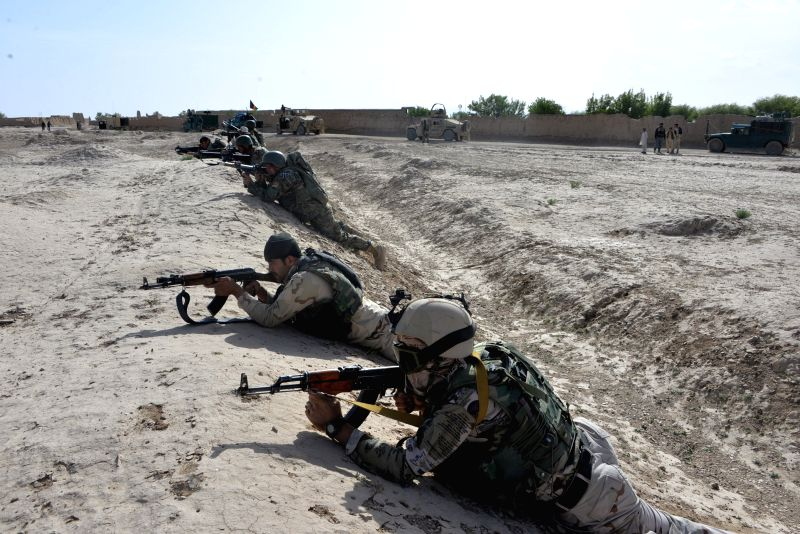 Afghan soldiers aim their weapons during an operation against Taliban in Ghazni province, western Afghanistan, May 3, 2015. (Xinhua/Rahmat)