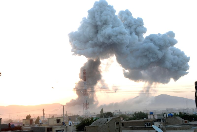 Smoke rises from the site of an attack in Ghazni province in eastern Afghanistan, Sept. 4, 2014. At least 24 people were killed while 150 others wounded after ...