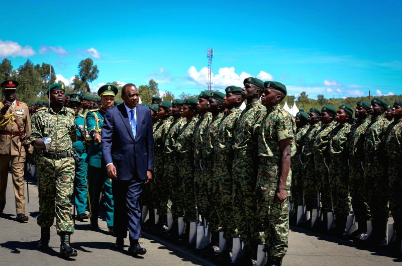 GIL GIL (KENYA), April 24, 2015 Kenyan President Uhuru Kenyatta (in suit) inspects graduates of the National Youth Service (NYS) Gil Gil college, during a graduation ceremony in Gil Gil, ...