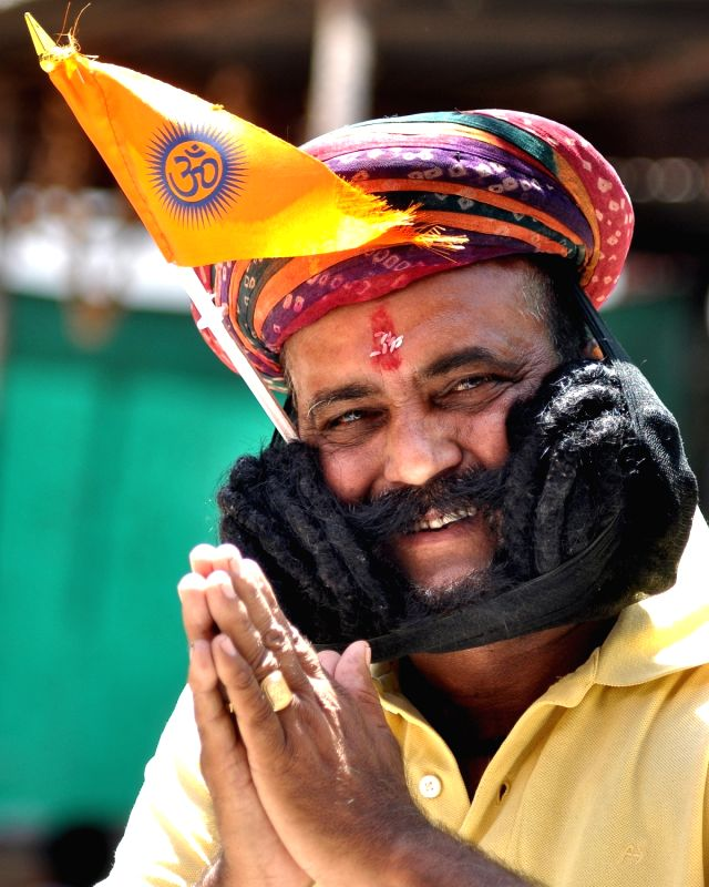 Giridhar Vyas of Rajasthan dons his 18 ft long moustaches in Bikaner.