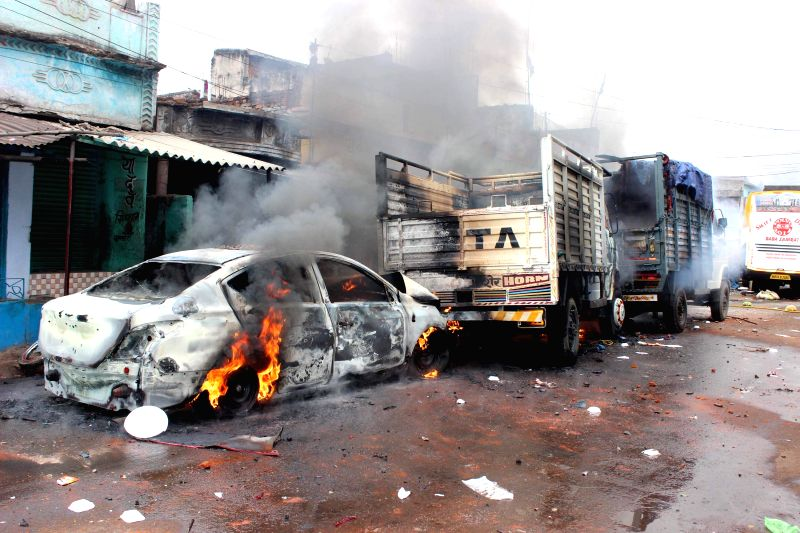 A car set ablaze after a clash erupted between two groups in Giridih of Jharkhand on Jan 4, 2015.