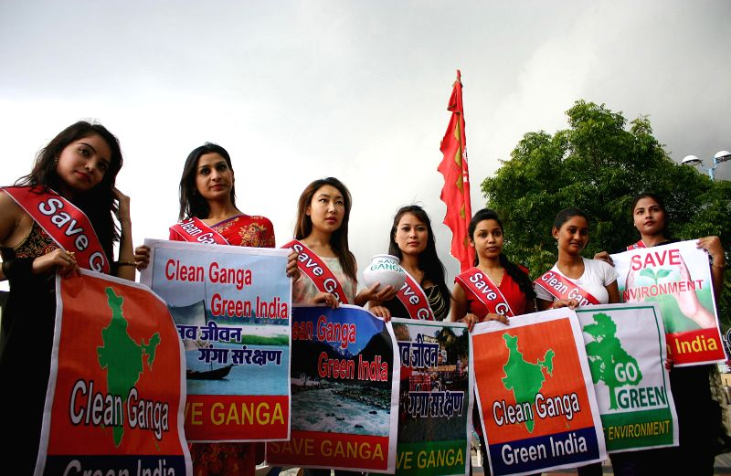 Girl's pose for photograph during 'Save Ganga Green India' - a social campaign at boat club in Bhopal on Aug 28, 2014.