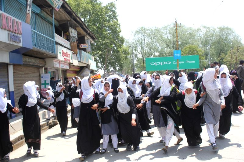 Girl students stage a demonstration in Sopore of Jammu and Kashmir on May 4, 2017.