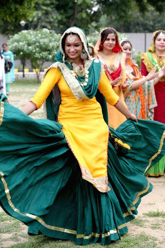Girls enjoy dancing ahead of Teej festival celebrations, in Amritsar, on Aug 10, 2018.