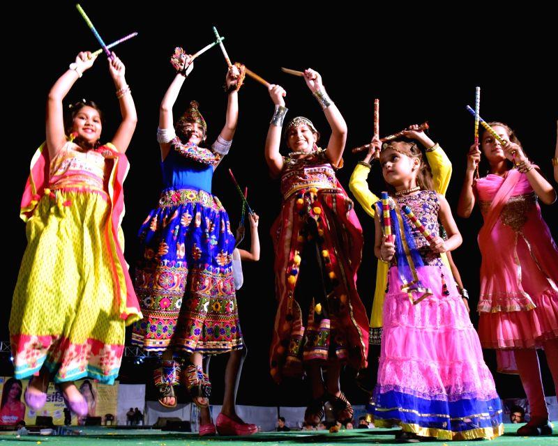Girls perform Dandiya during Navratri in Bikaner of Rajasthan.