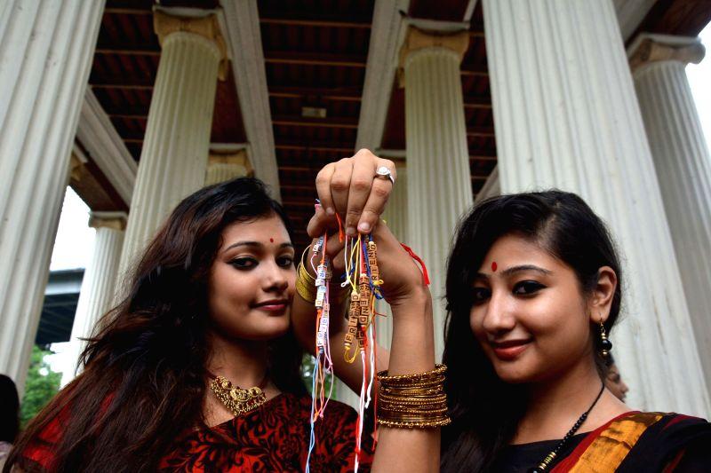 Girls show friendship bands in Kolkata on Aug 7, 2016.