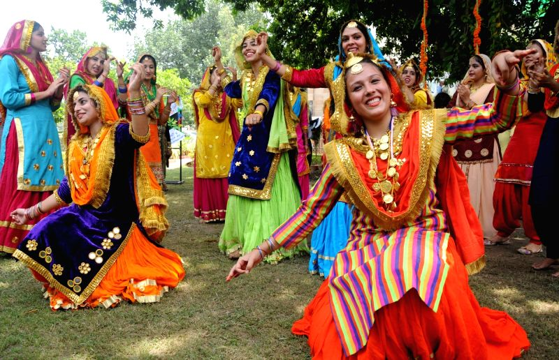 Girls wearing traditional attire participate in Teej celebrations, in Amritsar on Aug 1, 2018.