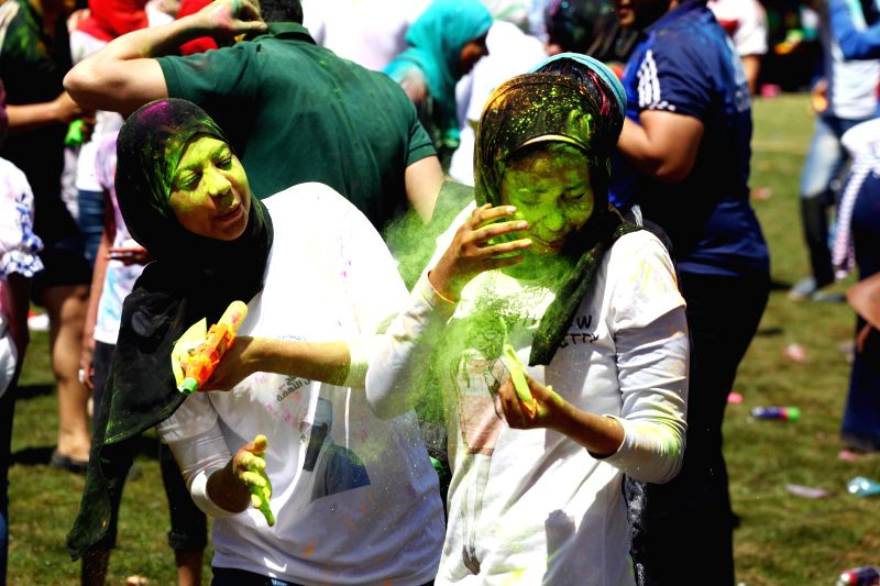 Egyptian young people participate in the color festival in Giza, Egypt, on April 25, 2015. Participants smashed colored powder on each other during the popular annual ...