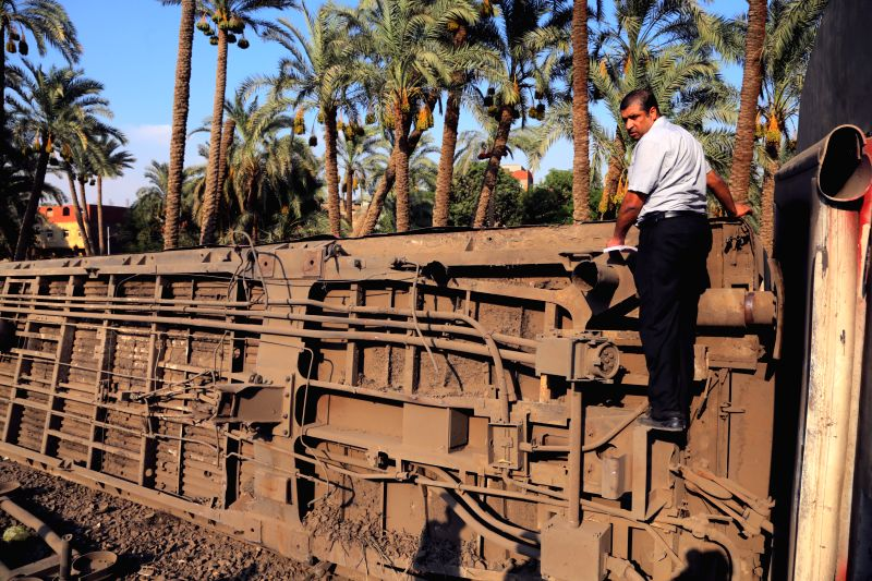 GIZA, July 13, 2018 - An Egyptian checks an overturned carriage at the accident site where a train derails in Giza, Egypt, July 13, 2018. At least 55 people were injured as an Egyptian train derailed ...