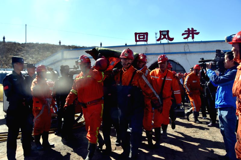 (gl/IANS)A trapped miner is carried out of the mine in Shenmu County of Yulin City, northwest China's Shaanxi Province, April 22, 2017. Six trapped miners were ...