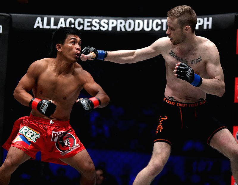 (gl/IANS)Kevin Belingon (L) of the Philippines competes against Toni Tauru of Finland during their men's bantamweight match in the One Championship in Pasay ...