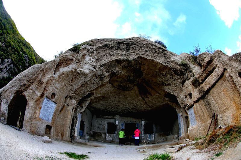 (gl/IANS)Tourists visit a rock cave of the Northern Wei Dynasty (386-534) on Tianhuang Mountain in Huailai, north China's Hebei Province, April 21, 2017. ...
