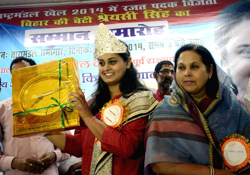 Glasgow, 2014 CWG silver medallist, Indian shooter Shreyashi Singh being felicitated during a programme organised in Patna on Aug 18, 2014.
