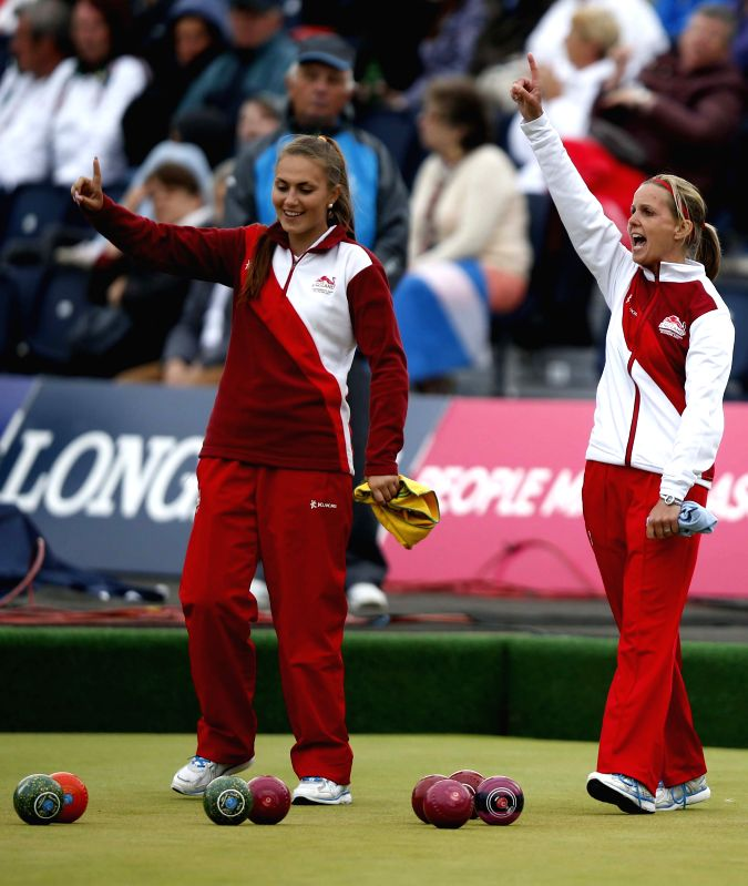 Ellen Falkner (R) of England celebrates with her teammate Sophie Tolchard during the women's triples gold medal match of Lawn Bowls between England and Australia on .