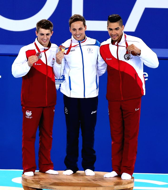 Gold medalist Daniel Keatings (C) of Scotland, silver medalist Max Whitlock (L) of England and bronze medalist Louis Smith of England pose during the awarding ...