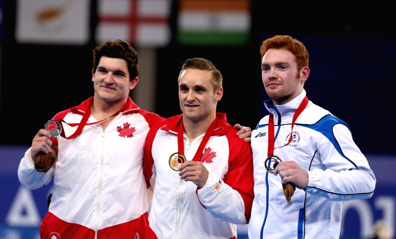 Gold medalist Scott Morgan (C) of Canada, silver medalist Kevin Lytwyn (L) of Canada and bronze medalist Daniel Purvis of Scotland pose during the awarding ceremony .