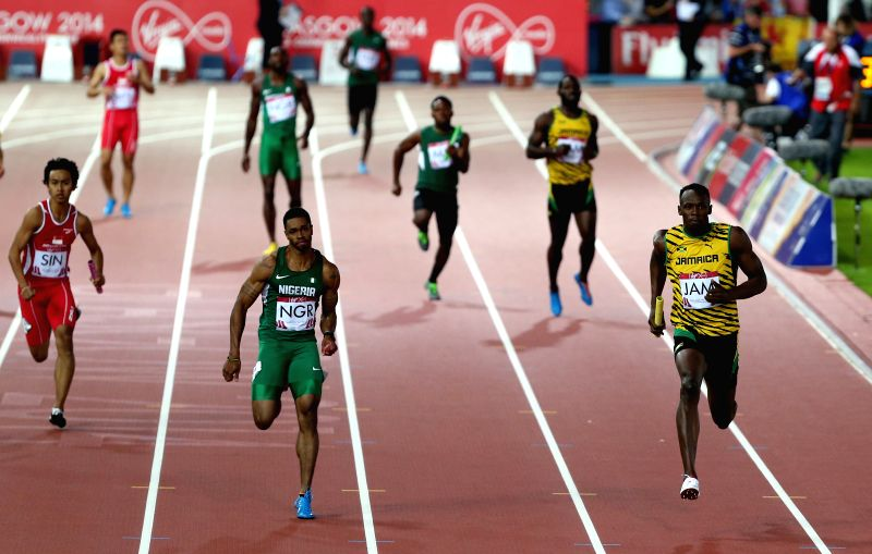 Usian Bolt (1st R) of Jamaica competes during the men's 4X100m relay round 1 of Athletics at the 2014 Glasgow Commonwealth Games in Hampden Park in Glasgow, Scotland