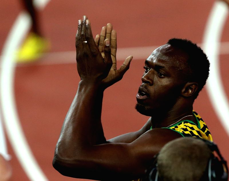 Usian Bolt of Jamaica greets the spectators after the men's 4X100m relay round 1 of Athletics at the 2014 Glasgow Commonwealth Games in Hampden Park in Glasgow, ...