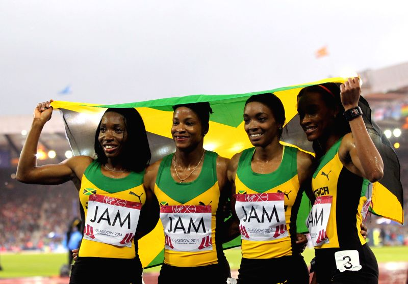 Athletes of Jamaica react after the women's 4X400m relay final of Athletics at the 2014 Glasgow Commonwealth Games in Hampden Park in Glasgow, Scotland on Aug. 2, ...