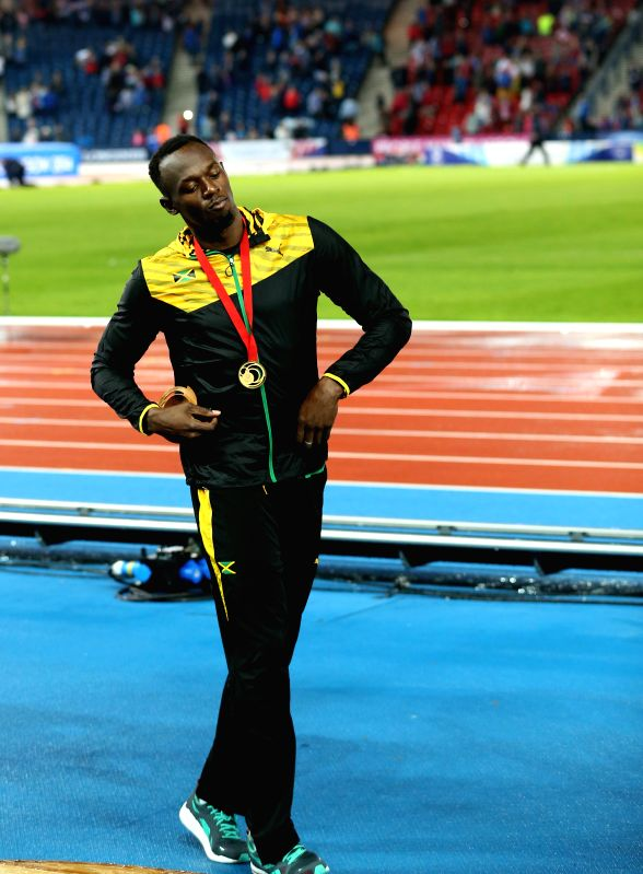 Usain Bolt of Jamaica reacts during the awarding ceremony for the men's 4X100m relay final of Athletics at the 2014 Glasgow Commonwealth Games in Hampden Park in ...