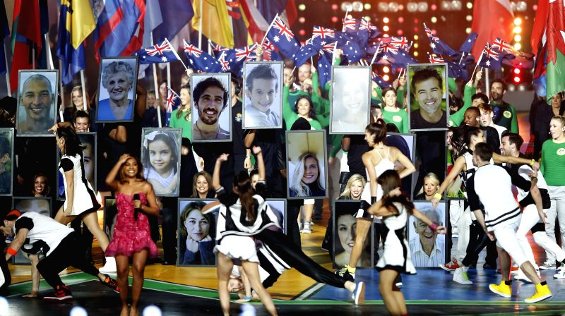 People perform on stage after Gold Coast 2018 flag handover during the closing ceremony for the Glasgow 2014 Commonwealth Games at the Hampden Park in Glasgow, the ..