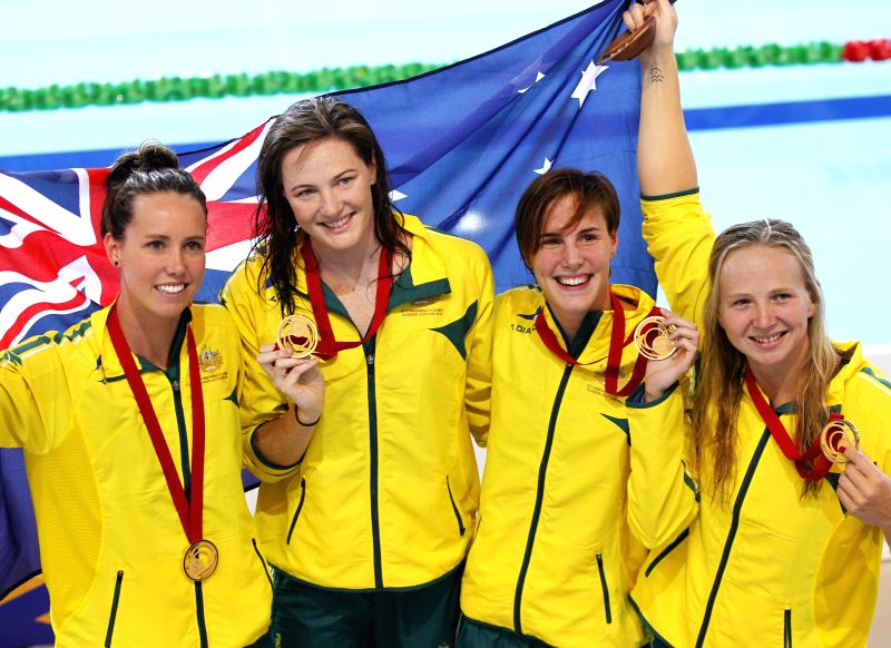 Emma McKeon, Cate Campbell, Bronte Campbell and Melanie Schlanger of Australia show their gold medals after the medal ceremony for the Women's 4X100m ... - Cate Campbell