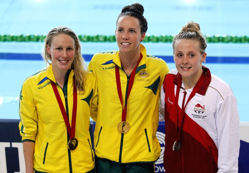 Gold medallist Emma McKeon (C) of Australia poses with silver medallist Siobhan O'Connor (R) of England and bronze medallist Bronte Barratt of Australia after the ..