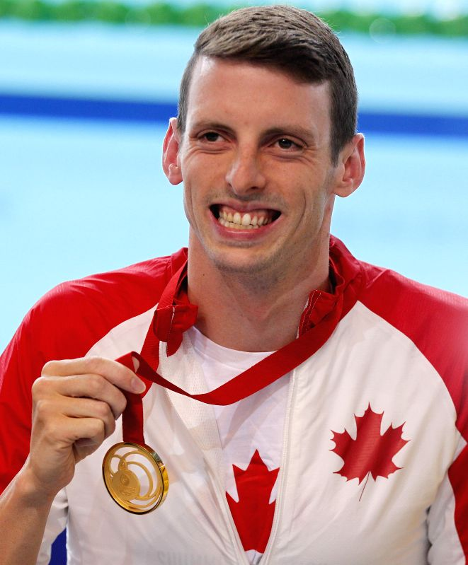 Ryan Cochrane of Canada shows his gold after the medal ceremony for Men's 400m Freestyle Final during day 1 of the Glasgow 2014 Commonwealth Games at Tollcross ...