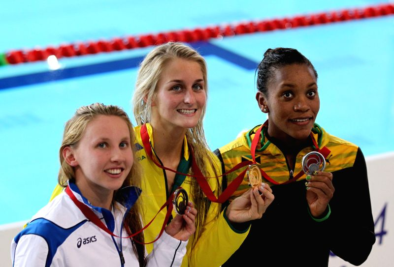 Leiston Pickett (C) of Australia displays the gold medal during the awarding ceremony for the women's 50M breaststroke final at the 2014 Glasgow Commonwealth Games .