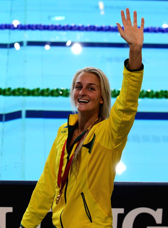 Leiston Pickett of Australia greets the audience during the awarding ceremony for the women's 50M breaststroke final at the 2014 Glasgow Commonwealth Games held in .