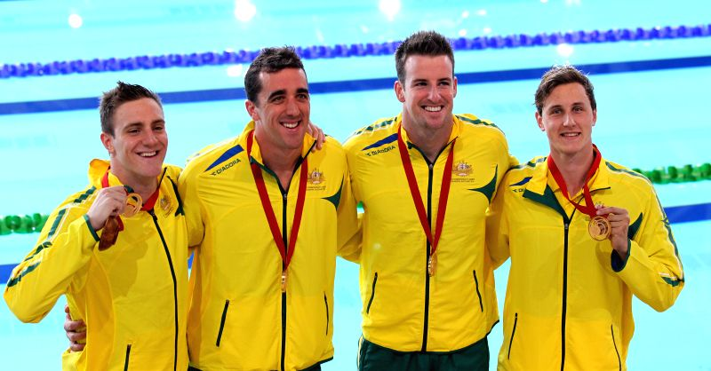 Swimmer of Australia pose during the awarding ceremony for the Men's 4x100M Freestyle Relay Final during day 2 of the Glasgow 2014 Commonwealth Games at Tollcross ...
