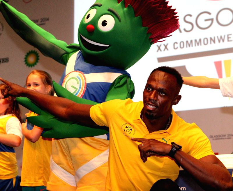 Usain Bolt of Jamaica poses for aphoto during a press conference on day 3 of the Glasgow 2014 Commonwealth Games in the Loch Lomond room at the MPC in Glasgow, ...