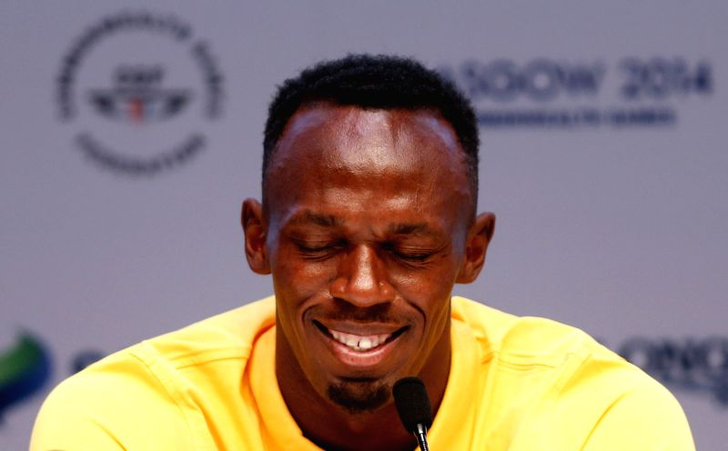 Usain Bolt of Jamaica reacts during a press conference on day 3 of the Glasgow 2014 Commonwealth Games in the Loch Lomond room at the MPC in Glasgow, Scotland on ...