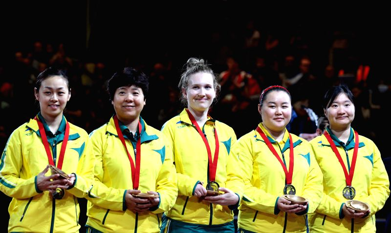 Players of Australia pose for a group photo on the podium during the awarding ceremony for the women's team final of table tennis at the 2014 Glasgow Commonwealth ..