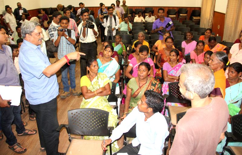 Goa Chief Minister Manohar Parrikar interacts with Cavrem villagers who are against mining operations in their village during a meeting in Panaji on May 14, 2014.