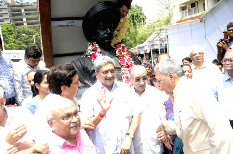 Goa Chief Minister Manohar Parrikar with BJP leader Mangal Prabhat Lodha during the inauguratation of social worker Jaganath Sunkarseth memorial at Grant Road in Mumbai on Aug. 23, 2014.