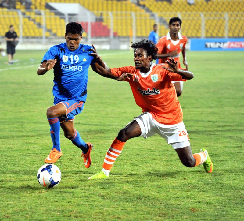 Players in action during a Federation Cup match between Sporting Clube de Goa and Dempo Sports Club in Goa, on Jan 1, 2015.