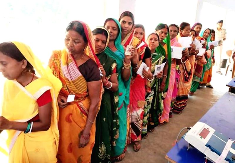 Godda: People queue-up to cast their votes during the seventh and the last phase of 2019 Lok Sabha Elections at a polling booth in Godda, Jharkhand on May 19, 2019.