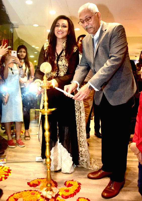 Godrej Interio Chief Operating Officer Anil S. Mathur and actress Rituparna Sarkar light the lamp  during the inauguration of a store of Godrej Interio, in Kolkata on July 25, 2018. - Rituparna Sarkar
