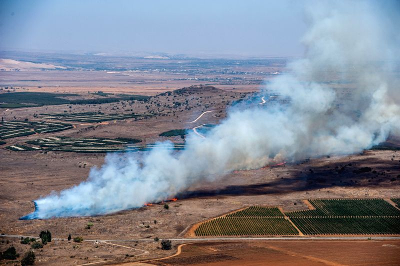 Smoke rises as a result of fighting between the Syrian army and rebels over the control of the border crossing of Quneitra on Israeli-occupied the Golan ...