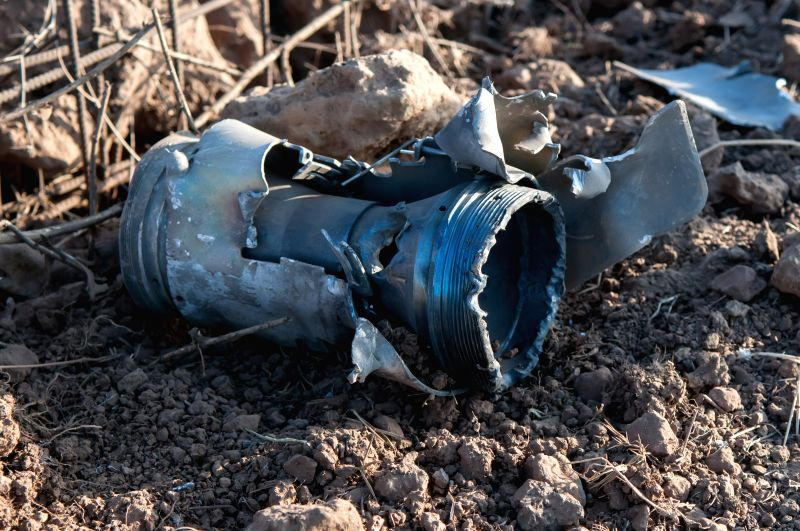 The remains of a rocket is seen near the Israeli border with Lebanon, in Golan Heights, on July 14, 2014. The rocket fired from Syria hit an open area on the .