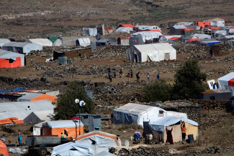 GOLAN HEIGHTS, July 18, 2018 - Photo taken on July 17, 2018 shows a refugee camp on the Syrian side of the Golan Heights near the cease fire line between Syria and Israel. (Xinhua/Ayal ...