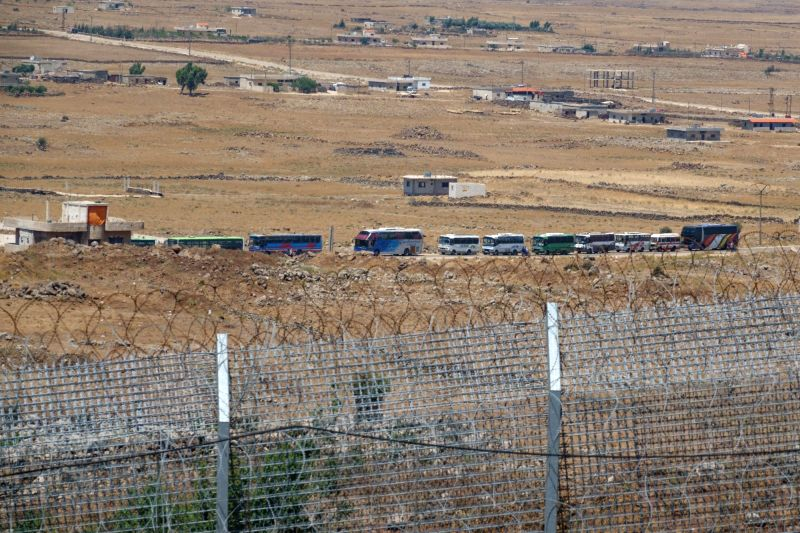 GOLAN HEIGHTS, July 20, 2018 - Photo taken from the Israeli-occupied Golan Heights on July 20, 2018 shows that Syrian rebels and civilians evacuate from Syria's southern province of Quneitra. A deal ...