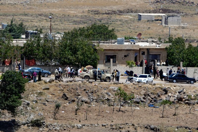 GOLAN HEIGHTS, July 20, 2018 - Photo taken from the Israeli-occupied Golan Heights on July 20, 2018 shows Syrian rebels and civilians getting ready to evacuate from Syria's southern province of ...