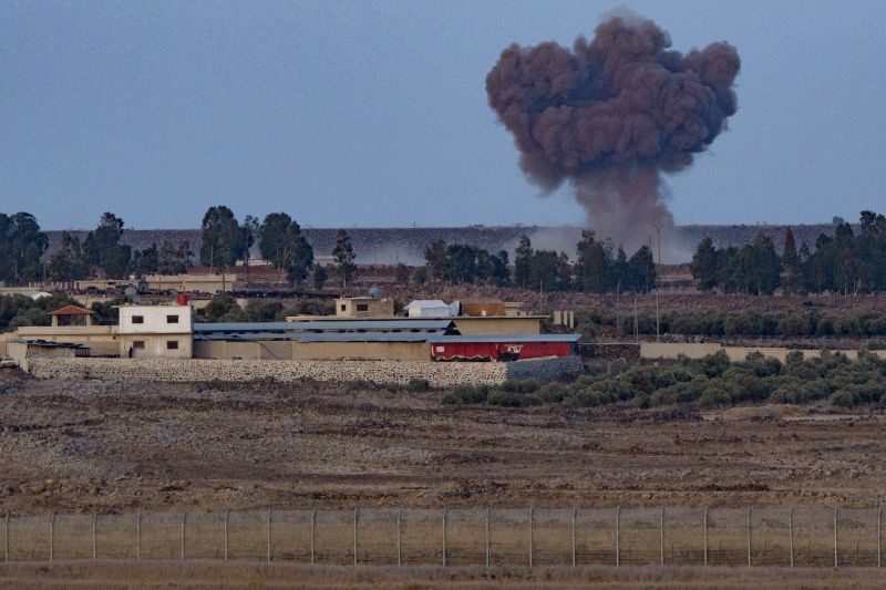 GOLAN HEIGHTS, July 24, 2018 - Photo taken on July 24, 2018 from the Israeli-occupied Golan Heights shows an explosion on the Syrian side near the ceasefire line between Syria and Israel. Israel ...