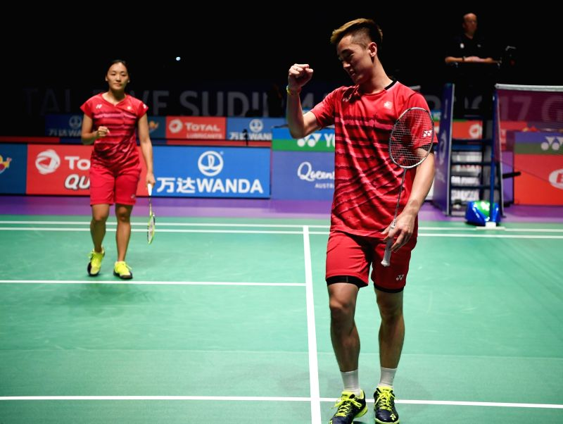 GOLD COAST, May 21, 2017 - Tang Chun Man (R) and Tse Ying Suet of Hong Kong, China celebrate during the mixed doubles match of Group 1-Group 1A against China's Chen Qingchen and Zheng Siwei at TOTAL ...