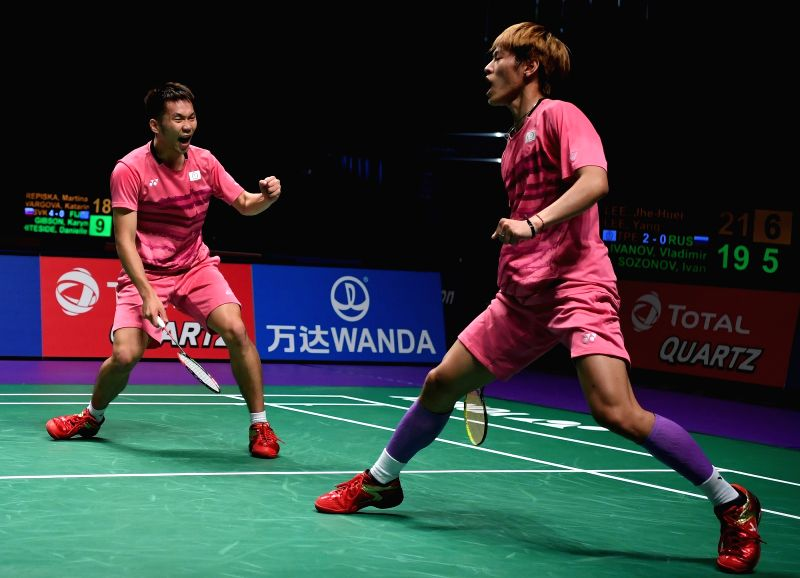 GOLD COAST, May 22, 2017 - Lee Jhe-Huei (R)/Lee Yang of Chinese Taipei celebrate during the men's doubles match of Group 1-Group 1B against Vladimir Ivanov/Ivan Sozonov of Russia at TOTAL BWF ...