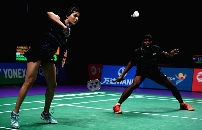 GOLD COAST, May 23, 2017 - Satwiksairaj Rankireddy(R)/Ashwini Ponnappa of India compete during the mixed doubles match of Group 1-Group 1D against Tontowi Ahmad/Gloria Emanuelle Widjaja of Indonesia ...