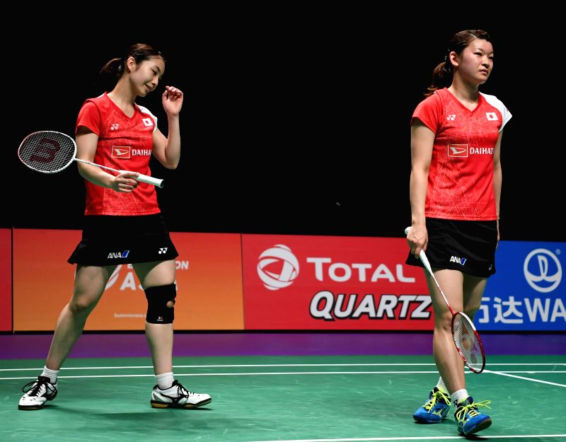 GOLD COAST, May 27, 2017 - Japan's Matsutomo Misaki/Takahashi Ayaka(R) react during the women's doubles match against China's Chen Qingchen/Jia Yifan at the semifinal between China and Japan at TOTAL ...