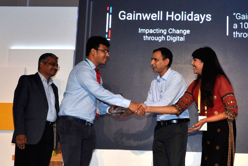 Google Director Marketing Solutions Shalini Girish and FICCI Startup Committee Co-Chair Yogesh Andlay with the winners of SMB Heroes 2017 during a programme in Kolkata, on June 13, 2017.